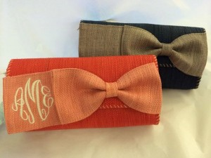 monogram clutch in coral and navy