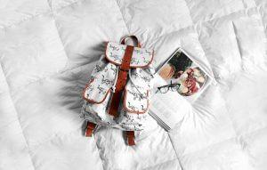 backpack on comforter