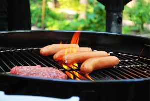 burgers and dogs on grill