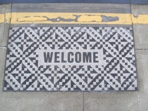 welcome mat on porch