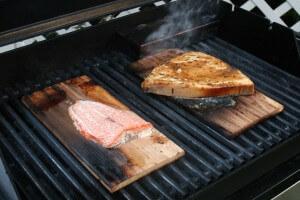 salmon grilling on cedar plank